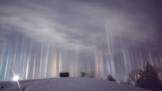 """During some cold, wintry nights, flat ice crystals that normally reside higher up in the atmosphere come fluttering closer to the ground, according to NASA. These whimsically wobbling ice crystals are sometimes referred to as crystal fog. When the crystals reflect ground lights from nearby cars and other bits of civilization, the result can be glorious: columns of light called """"light pillars."""""""