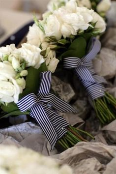A fun idea for Bridesmaids Bouquets  is to have the ribbon coordinate with the groomsmen's shirts.