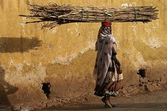 Woman carrying wood on her head, Ethiopia by Eric Lafforgue, via Flickr