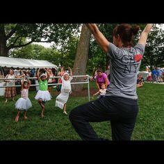 Julie Sunderland, director of education for the Cincinnati Ballet, instructs young children basic poses in Lumenocity Village Wednesday August 5, 2015. The Enquirer/Madison Schmidt