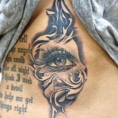 Eye tattoo by Carlos Torres.