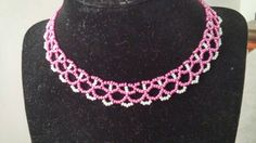Check out this item in my Etsy shop https://www.etsy.com/listing/237025430/metallic-pink-bead-choker