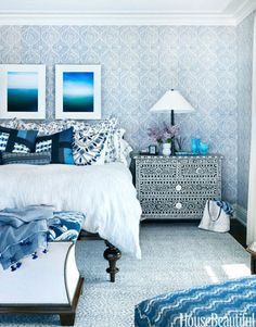 Moroccan accents are balanced by an intricate blue rug in the bedroom of a Lake Michigan house designed by Martin Horner of Souci Horner.