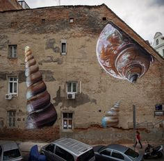 Glistening Snail Shells Painted on a Crumbling Croatian Facade by 'Lonac'