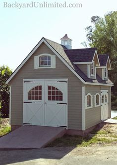 14'x20' Garden Shed with Steep Roof, Dormers, Lap Siding, Cupola, Arched Wood Windows with Trim and Shutters, Carriage House Double Door, and 8'x8' Carriage House Barn Door--Petaluma, California http://www.backyardunlimited.com/sheds.php