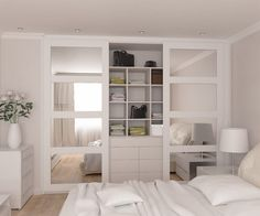 Fully fitted wardrobes range with mirrored doors in spray painted frames #fitness_room_mirror