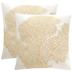 A decorator favorite, the beloved fan coral motif adorns this set of two indoor outdoor pillows in gold and cream. Crafted of long wearing, easy care polypropylene, their water-resistant fill and lend