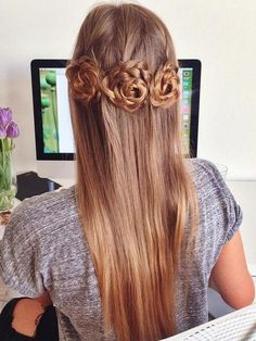 half updo for long hair with braided rosettes