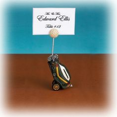 "For the Golfer in your life, Our Golf Cart placecard holders are the perfect way to display your wedding place cards. They will also make a perfect favor for your guests to display a photo. Each place card holder is made of poly resin and beautifully detailed. Each place card holder measures 1 1/2"" x 4"" and holds a 2"" x 3"" placecard or photo.  #weddingfavor #golf #placecard"