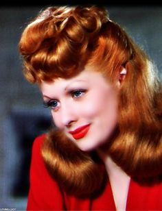 "Lucille Ball shows off her new hair color (""Tango Red"") in the lush Technicolor production of DuBarry Was a Lady (1943)."