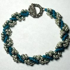 Spiral Drop Bracelet Pattern.   Dramatic bracelet makes up in about 2 hours. Learn how easy the DNA Spiral stitch is! This pattern is fully illustrated with detailed pictures and step-by-step instructions.