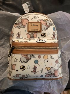 Loungefly Disney Dumbo Backpack on Mercari Cute Disney Outfits, Disney Themed Outfits, Disney Handbags, Disney Purse, Handbags Online, Cute Mini Backpacks, Stylish Backpacks, Disney Dumbo, Mini Mochila