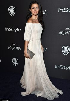 Showstopper: Earlier in the evening, the brunette beauty managed a small smile on the red carpet for the InStyle and Warner Brothers Globes after party at The Beverly Hilton Hotel