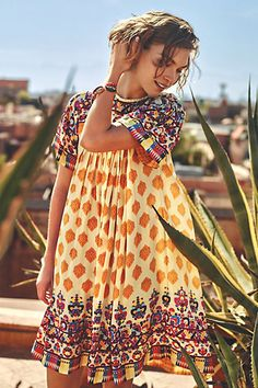 I'd probably wear this as a tunic rather than a dress but nice colors and pattern.