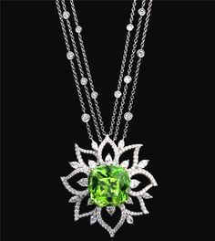 Pendant-necklace by Richard Krementz, Peridot set in yellow gold, in a platinum surround set with round, marquise and pear cut diamonds set in platinum. Peridot Jewelry, Peridot Necklace, Diamond Jewelry, Gemstone Jewelry, Pendant Necklace, Jewelry Art, Jewelry Accessories, Jewelry Necklaces, Fine Jewelry