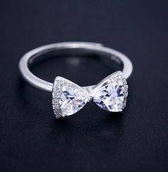 sterling silver and CZ bow ring http://www.jewelsin.com/p-stunning-gift-bling-cz-bow-ring-for-girls-1358