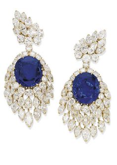 A PAIR OF IMPRESSIVE SAPPHIRE AND DIAMOND EAR PENDANTS, BY M. GÉRARD Each detachable pendant set with an oval-shaped sapphire, weighing 52.72 and 49.84 carats, within a brilliant-cut diamond surround to the marquise-cut diamond fringe suspended from a marquise and brilliant-cut diamond surmount, 8.5 cm long, with French assay mark for gold Signed M. Gérard, no. 1881