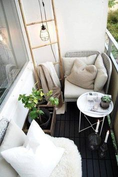 Love the corner chair - what a sweetly styled balcony to enjoy