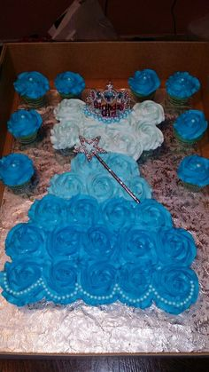 Frozen Theme Cupcake Dress and Pearl Topped Cupcakes, (Elsa Dress) with blue Pearls at the neckline, topped with a crown, also blue pearls at the bottom of the dress