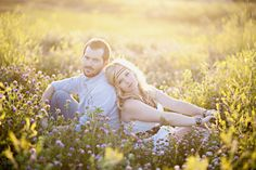 engagement picture ideas. i love the lighting in this picture and the couple being outside in a meadow; it looks clean and simple yet interesting.