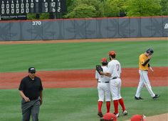 Troy Kukn (left) and Jacob Bosiokovic admire their work on the scoreboard after the 3-0 Sunday shutout.