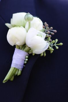 For the boutonniere - purple-tinged ranunculus, with eucalyptus