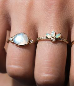 This ring really is magical. Three fiery opals meet to a center rose cut diamond in this enchanting piece. Six white diamonds on each side of the band complete this beautiful and unique piece. Set in