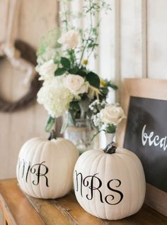 and Mrs. Pumpkins for a Fall Wedding - 17 Homemade Wedding Decorations for Couples on a Budget - EverAfterGuide Mr. and Mrs. Pumpkins for a Fall Wedding - 17 Homemade Wedding Decorations for Couples on a Budget - EverAfterGuide Homemade Wedding Decorations, Fall Wedding Centerpieces, Fall Decorations, Centerpiece Ideas, Wedding Arrangements, Halloween Wedding Decorations, Fall Wedding Table Decor, Wedding Reception Decorations On A Budget, Classy Halloween Wedding