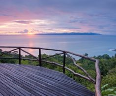 Start the day with a sunrise yoga session on Lapa Rios' spectacular hilltop deck.