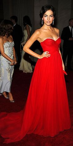 CAMILLA BELLE  Looking like the picture of 50s elegance, the raven-haired star sets off her classic beauty with a red chiffon Jason Wu gown, Cartier jewelry and Christian Louboutin accessories.