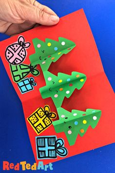 Christmas Tree Cards made from paper chains, easy Christmas tree pop up cards! How lovely are these smiling Pop Up Christmas Tree Cards? Love how fun and easy they are to make! The perfect pop up Christmas Card for kids 3d Christmas Tree Card, Christmas Pops, Homemade Christmas Cards, Xmas Cards, Diy Cards, Paper Crafts For Kids, Christmas Crafts For Kids, Handmade Christmas, Christmas Projects