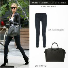 Rosie Huntington Whiteley in black biker jacket, white top, blue skinny jeans, black suede ankle boots and black leather tote