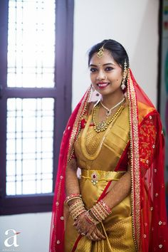 South Indian bride. Temple jewelry. Jhumkis.Gold silk kanchipuram sari with contrast red blouse.Braid with fresh jasmine flowers. Tamil bride. Telugu bride. Kannada bride. Hindu bride. Malayalee bride.Kerala bride.South Indian wedding