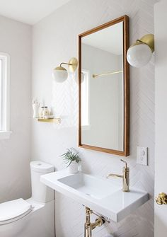 Before and After: A Small But Mighty Bathroom Makeover for the Minimalist in All of Us | Curbly