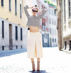 Summer season is almost here. Get the right look with a striped t-shirt, white broad pants and lace up heeled sandals. Like this idea?