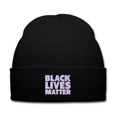 Black Lives Matter (Lavender Graphic) Black Knit Cap - This practical beanie does exactly what you think it will – keep your head warm when it's getting colder out there. And your ears will thank you for wearing it as well. The hat is easy to wear and just as easy to stow away in your pocket or bag. One size fits all. 100% acrylic.