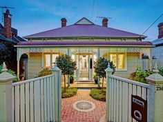 Beige and white Victorian house with red roof. 214 Hope Street BRUNSWICK WEST $1,000,000-$1,100,000 @ domain.com.au