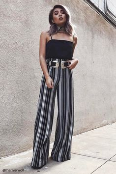 A pair of woven palazzo pants featuring an allover striped pattern and a concealed back zipper.