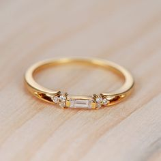Hey, I found this really awesome Etsy listing at https://www.etsy.com/listing/495270773/baguette-diamond-ring-in-14k-yellow-gold