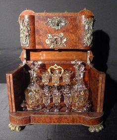 Extraordinary burl walnut Tantalus set with bronze mounts, baccarat glasses and hunting scene