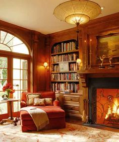 Library with fireplace, vintage rug, cozy oversized chair, sconces <-- So much goodness in one spot, it's overwhelming.