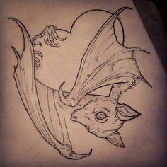 Adorable bat tattoo