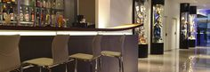 HOTEL BOCA | El Hotel Santorini, Design Suites, Conference Room, Table, Training Center, Furniture, Home Decor, Bar Stand, Houses