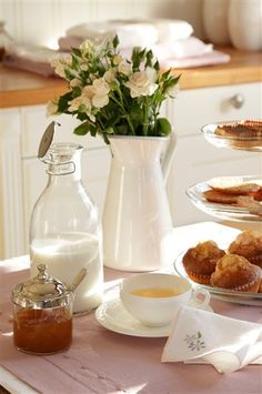 Enjoy breakfast: fresh flowers in a pitcher are easy and set the tone for a beautiful day.