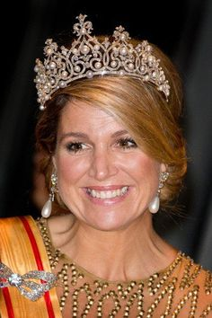 It wasn't only the dress that made Queen Máxima sparkle — the Queen had been rummaging through the royal vault and found some rather spectacular jewels to top off her majestic appearance. The diamond brooch on Máxima's sash is part of the Stuart Parure and can be combined into many variations with removable parts. On her head, she wore a very special tiara — the Württemberg Tiara, one of Princess Beatrix's favourites.