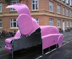 Car shaped #Bike storage containers placed on car parking spaces in Copenhagen