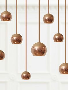 Remind me of the Tom Dixon copper pendants, these have wood sections. Vis Dpages.