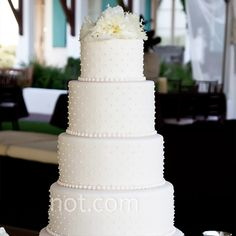 from the knot: pearl-studded white cake (photo by vue photography, cake by confections on the coast) - love the dots!