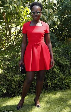 The lady in red: Lupita Nyong'o put on a striking sartorial display in a structured scarle...