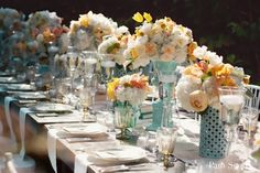 The blue vases are unique and the yellow and white flowers compliment them well....The pale blues, creams and yellows are perfect for a spring wedding. I LOVE LOVE LOVE these colors together!!!!!!!!!!!!!